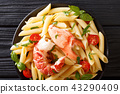 Italian recipe of penne pasta with boiled lobster 43290409