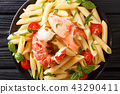 Served Penne pasta with red lobster meat, tomato 43290411