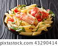 Italian recipe of penne pasta with boiled lobster 43290414