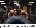 strong bodybuilder athletic men pumping up muscles 43292481