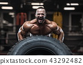 strong bodybuilder athletic men pumping up muscles 43292482