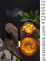 Yellow beautiful pumpkin with cut out pattern for the holiday of autumn. Decor for Halloween. Black 43293532