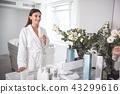 woman bathrobe drink 43299616
