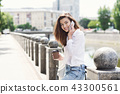 Beautiful smiling girl talking on smartphone outdoors 43300561