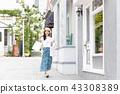 A young woman who enjoys shopping 43308389