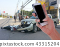 Man using smartphone after car accident 43315204