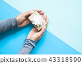 Top view of woman hands holding small gift 43318590