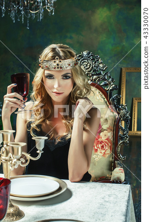 young blond woman wearing crown in fairy luxury interior with em 43330070