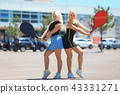 two young female tennis players 43331271