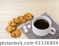 Cup of coffee with cookie on wood table. 43336804