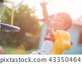 Happy little girl having fun on a playground 43350464