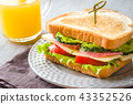 Sandwich with cheese, ham and fresh vegetables  43352526