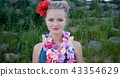Hawaii woman with flower lei garland of pink orchids. Beautiful smiling caucasian woman in bikini on 43354629