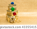 Gift boxes ribbon bow golden background Holidays 43355415