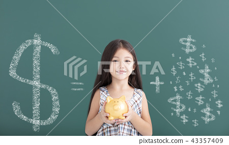 girl holding piggy bank and save money concept 43357409