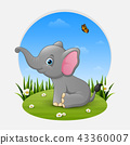 Cartoon happy elephant sitting on the grass 43360007