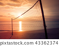Volleyball net on the beach with seascape. 43362374