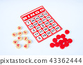 Red bingo card with white chip. 43362444