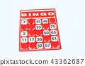 Red bingo card with red chip. 43362687