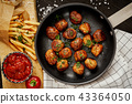 meat balls in a pan and golden crispy fries on a black old table 43364050