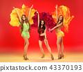 young beautiful dancers posing on studio background 43370193