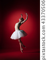 Ballerina. Young graceful female ballet dancer dancing at red studioskill. Beauty of classic ballet. 43370506