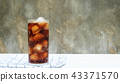 Iced aerated soft drink on a white wooden table. 43371570