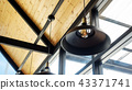 The lamp hanging from a ceiling. 43371741