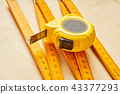 ruler and tape measure on wooden board 43377293