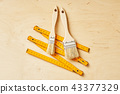 ruler and brush for painting on a wooden board 43377329