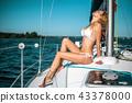 woman in white bikini on sale boat yacht 43378000
