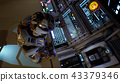 Astronaut of the future presses the keys on sci-fi screen. Realistic motion background. 3D Rendering 43379346