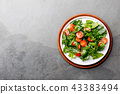 Fresh summer salad with baby spinach and tomatoes cherry. Top view, copy space. Slate gray 43383494