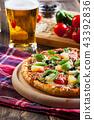 Pizza hawaii with beer 43392836