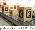 Appliance in cardboard boxes on conveyor line 43398357
