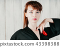 a pretty girl in a black dress, with red castanets 43398388