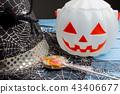 Pumpkin bucket, witch's hat and lollipop Halloween 43406677
