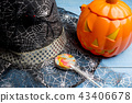 Pumpkin bucket, witch's hat and lollipop Halloween 43406678