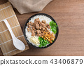 boiled rice with pork and vegetable in a bowl. 43406879