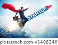 Superhero businessman in start-up concept flying rocket 43408240