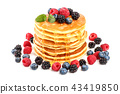Pancakes stack with different berries and honey isolated on white background 43419850