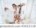 Smiling girls making selfie at spa salon 43422116