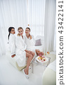 Three beautiful girls posing at spa salon 43422141