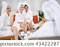 Lovely girls with towels on heads spending time at spa 43422287