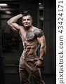strong bodybuilder athletic men pumping up muscles 43424171
