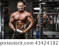 strong bodybuilder athletic men pumping up muscles 43424182