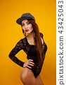 Sexy model with long hair in fashion cap and lace body 43425043