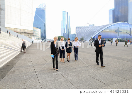 Business persons walking outside in  . 43425331