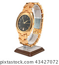 Golden wrist watch on the stand holder 43427072