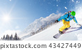Man snowboarder riding on slope. 43427449